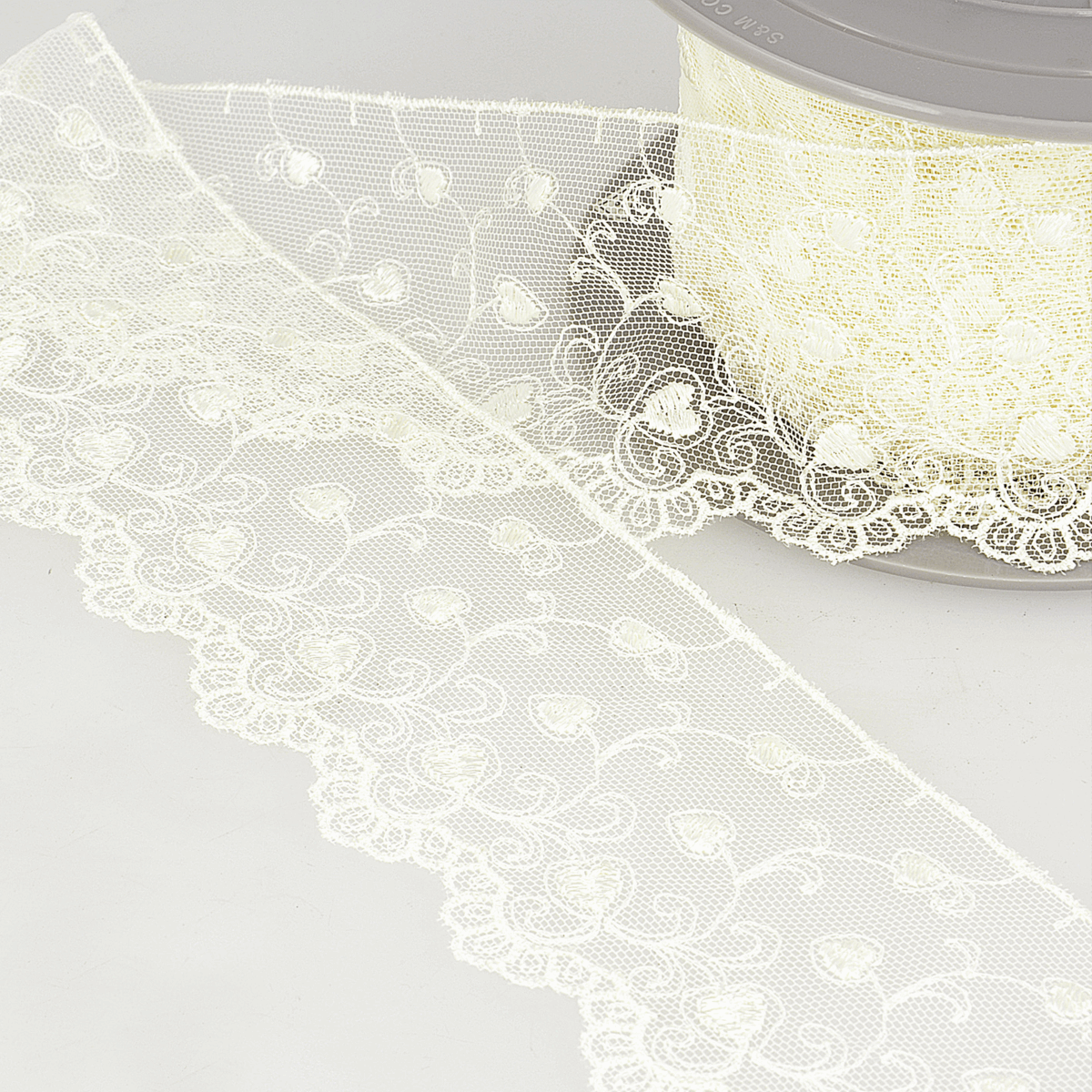 Picture of Embroidery on Tulle: Hearts: 14.6m x 70mm: Ivory